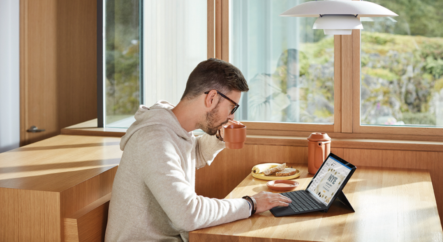 A lady working her Surface Laptop at home